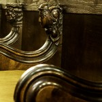 ornately carved heads on choir stalls