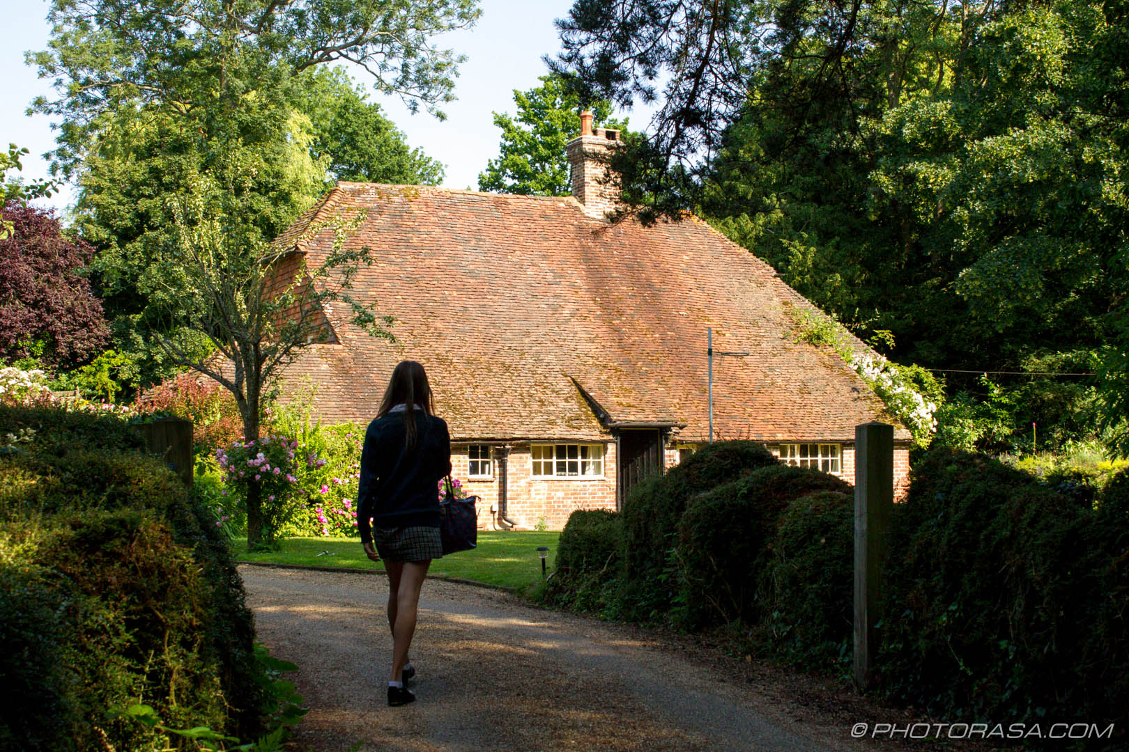 http://photorasa.com/chiddingstone-castle/girl-returning-home-to-high-roofed-house/