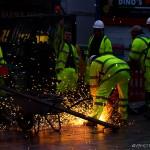 workmen making sparks fly