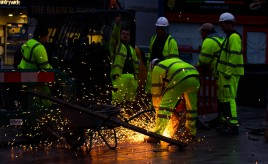workmen making sparks fly