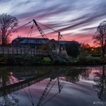 dramatic red sky at maidstone footbridge