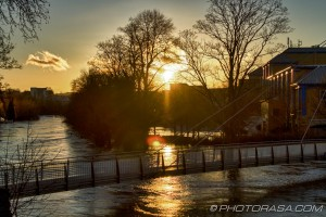 sunset over flooded medway and lockmeadow footbridge
