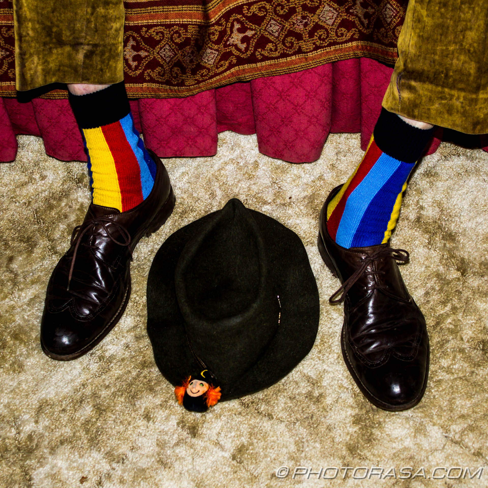 brogues, colorful stripey socks and a hat