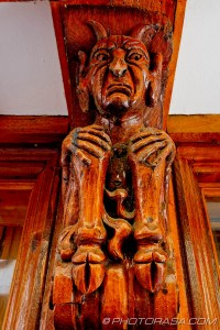 hooved pan carved into to wooden post