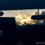 landscape through car front window