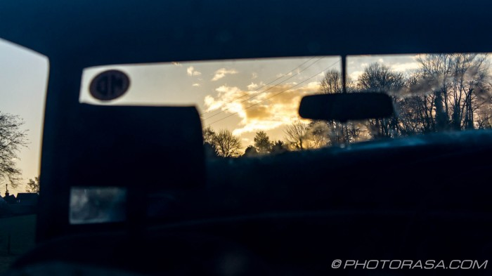 landscape through car front window