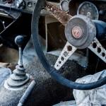 old mgb gt sports car wheel and gear stick