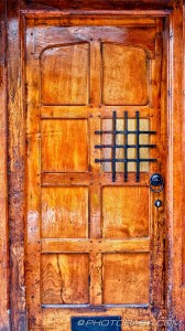 old wooden door with viewing panel