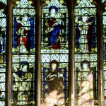 lady chapel stained glass window showing mary and baby jesus and saints