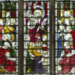 north stained glass window showing detail of jesus speaking to crowd