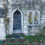 old wooden arched side door