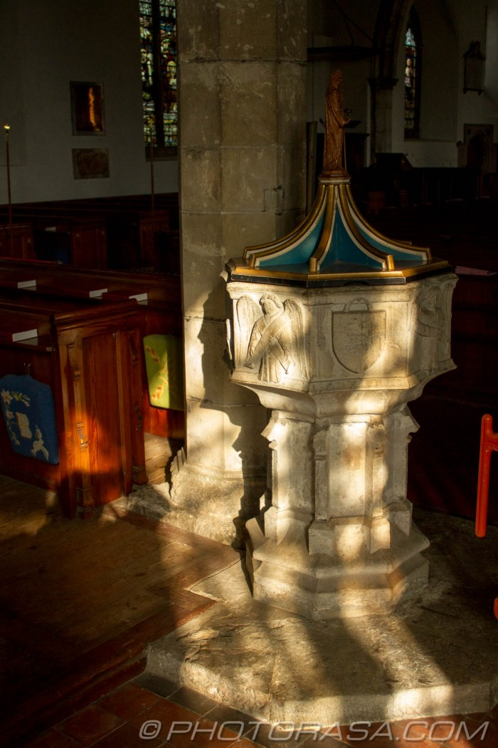 sun cast through windows on 14th century church font