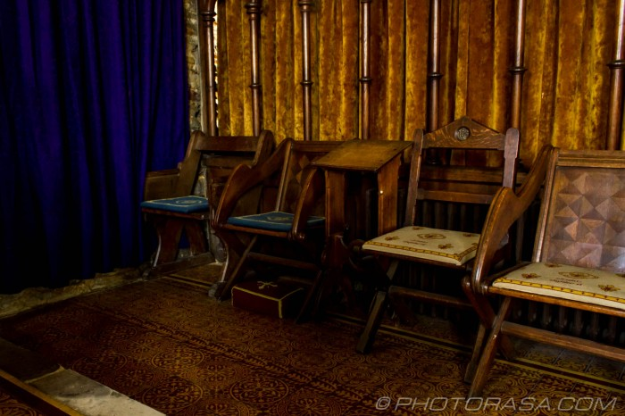 chairs and purple curtain