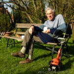 church neighbour with a cuppa and a strimmer