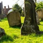 damaged and split stone grave