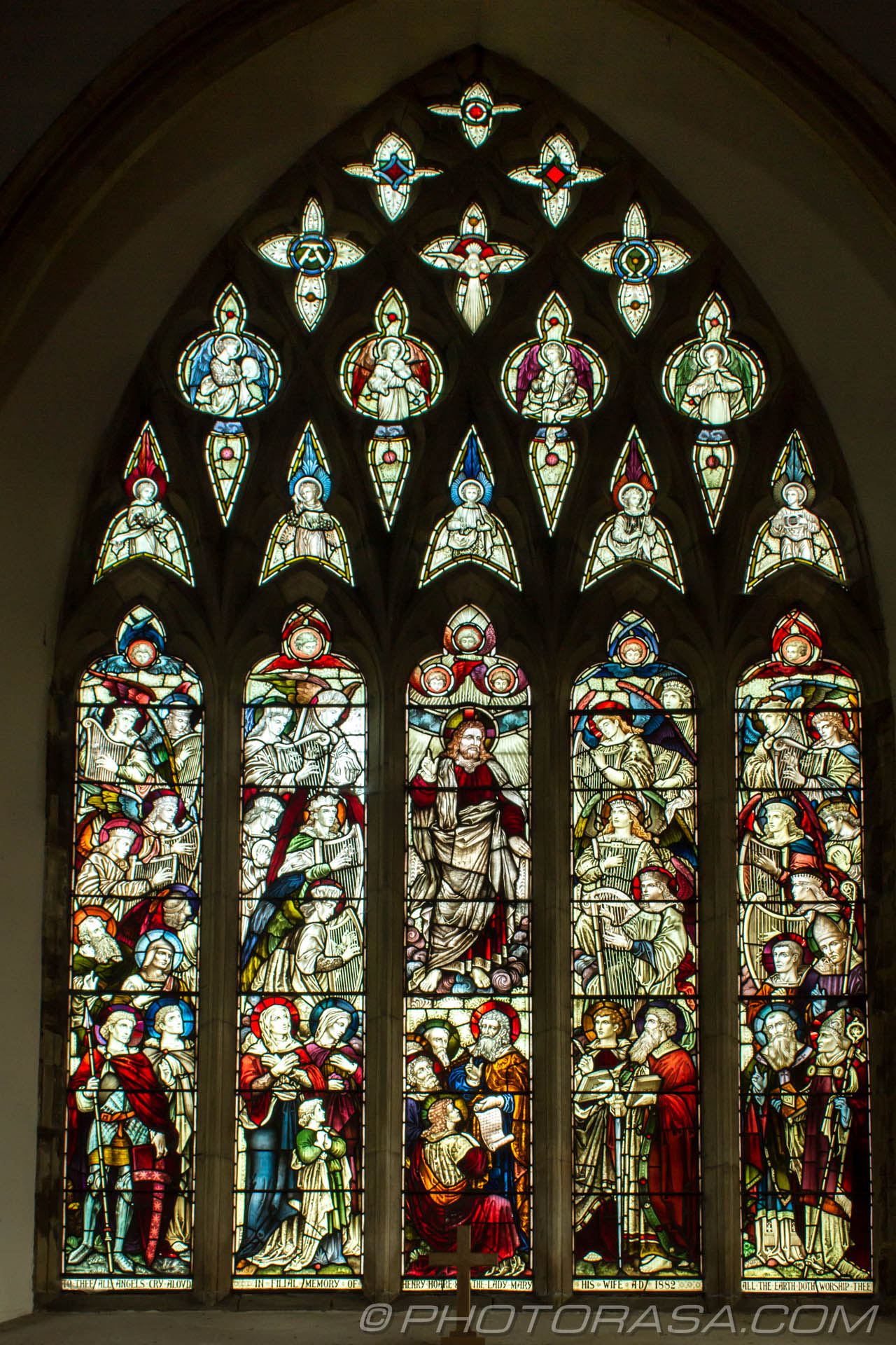 http://photorasa.com/saints-church-staplehurst-kent/stained-glass-of-jesus-surrounded-by-angels-and-saints/