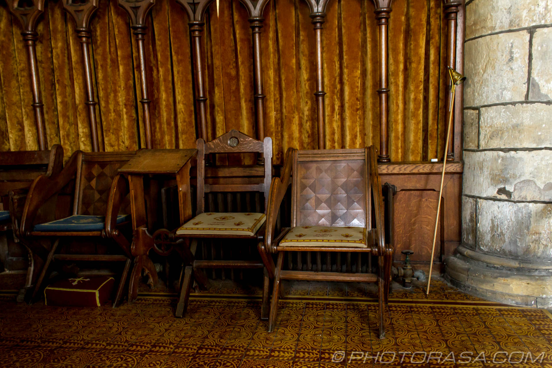http://photorasa.com/saints-church-staplehurst-kent/wooden-chairs-and-gold-candle-snuffer/