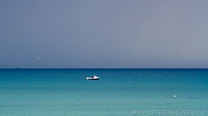 boat and stormy blue sea