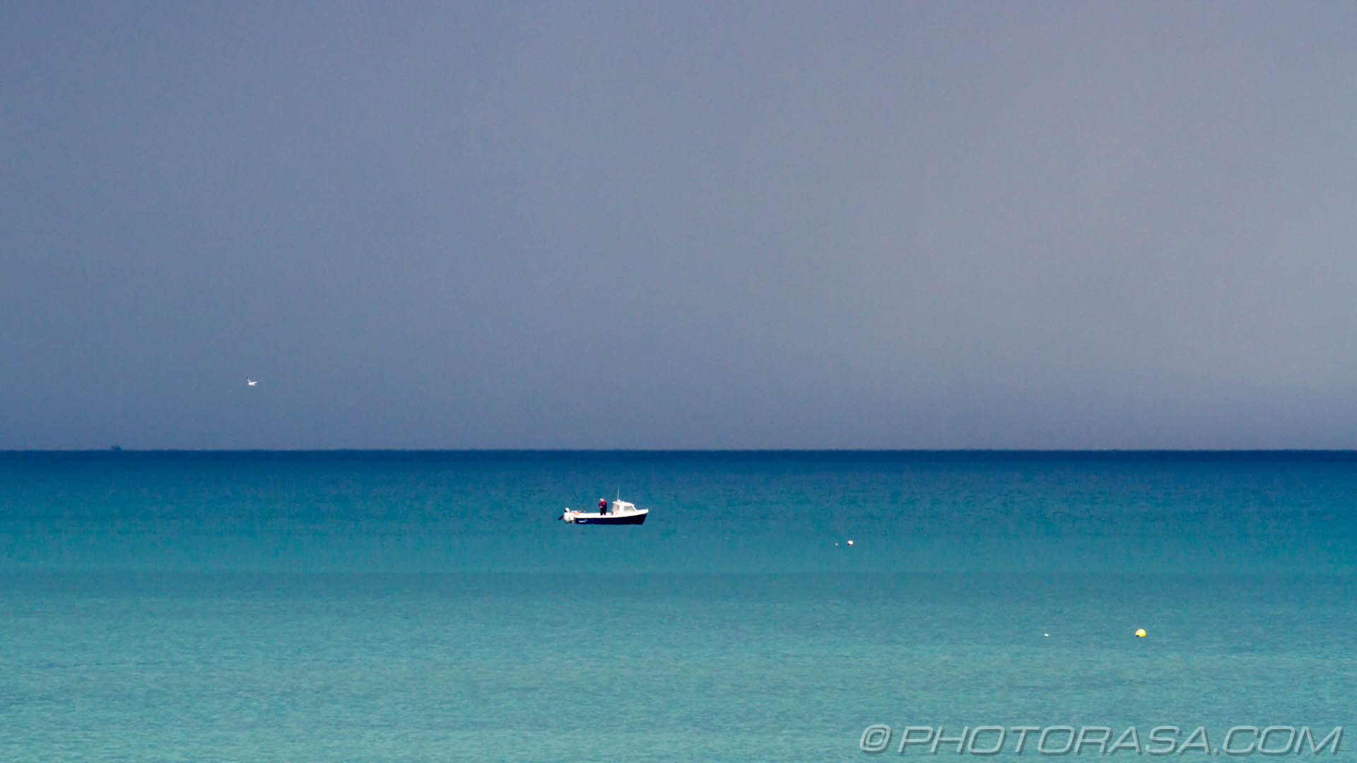 http://photorasa.com/sea-lyme-regis/boat-and-stormy-blue-sea/