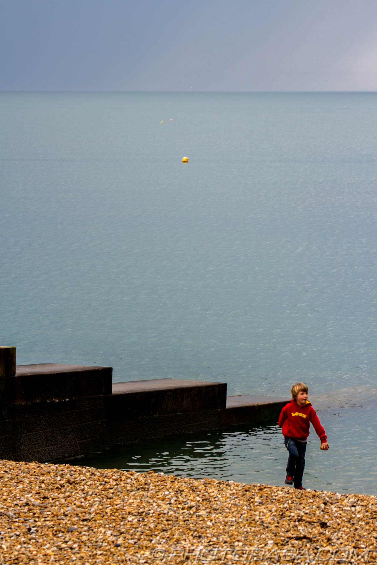 http://photorasa.com/sea-lyme-regis/buoy-and-boy/