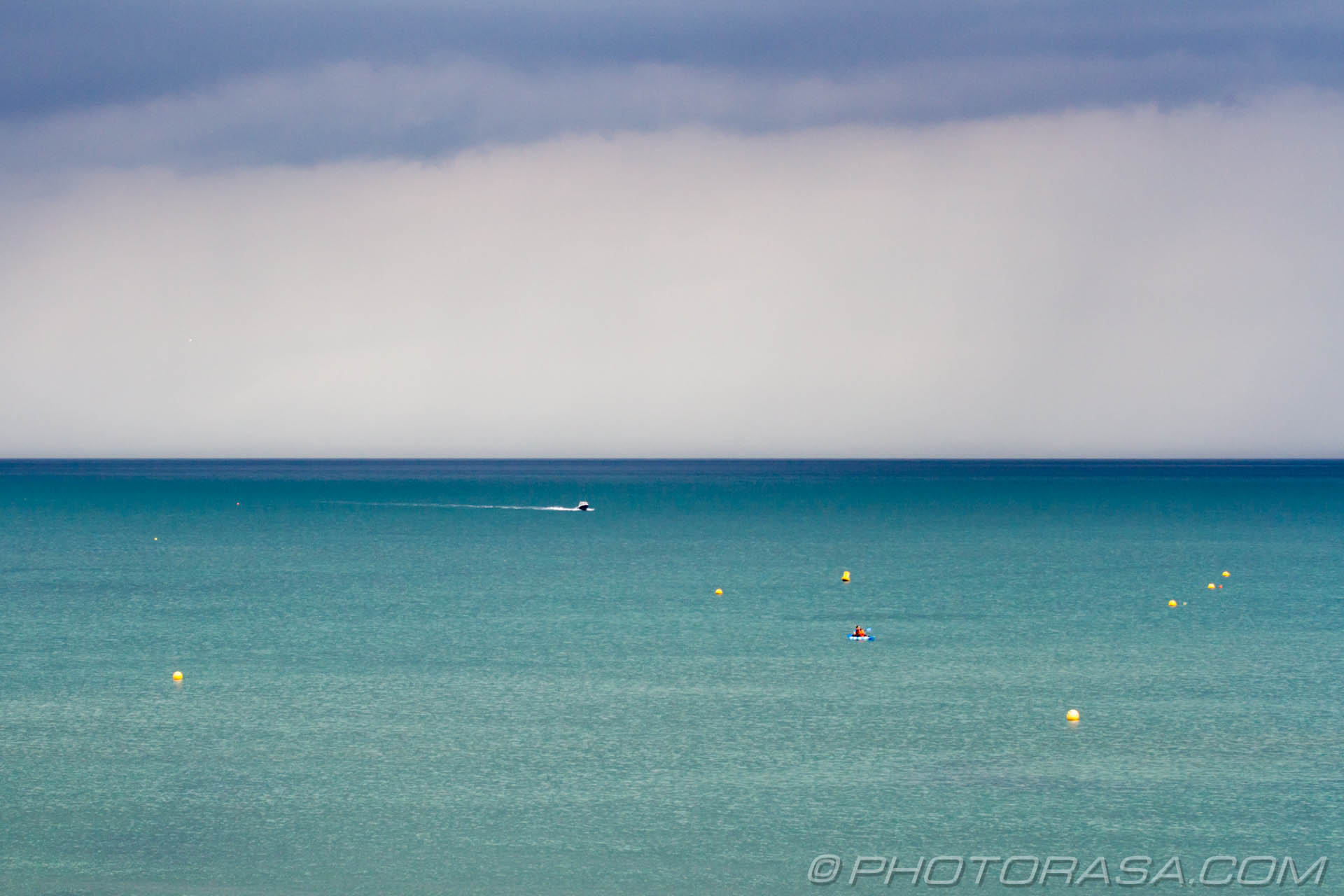 http://photorasa.com/sea-lyme-regis/buoys-and-boats-on-stormy-blue-sea/