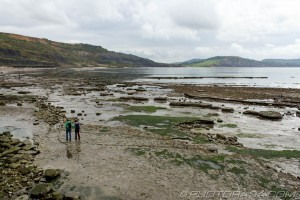 couple walking on jurassic beach