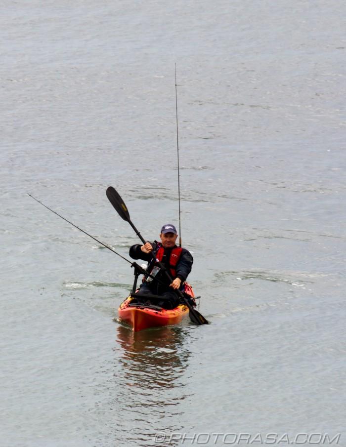 fisherman in canoe