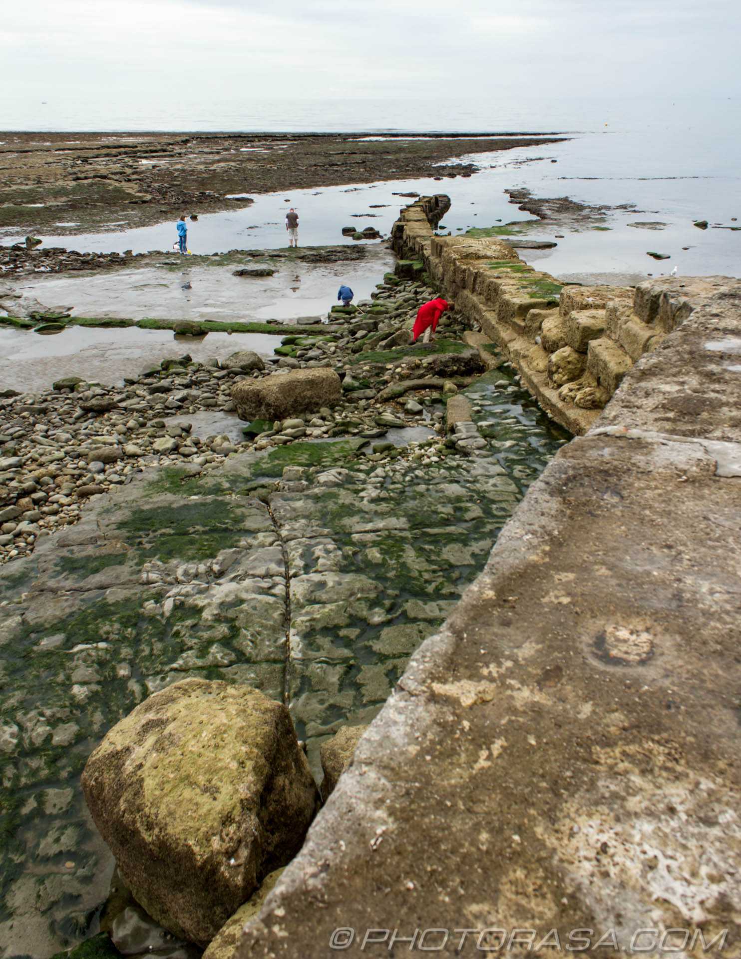 http://photorasa.com/jurassic-coast-lyme-regis/people-at-an-old-stone-breaker/
