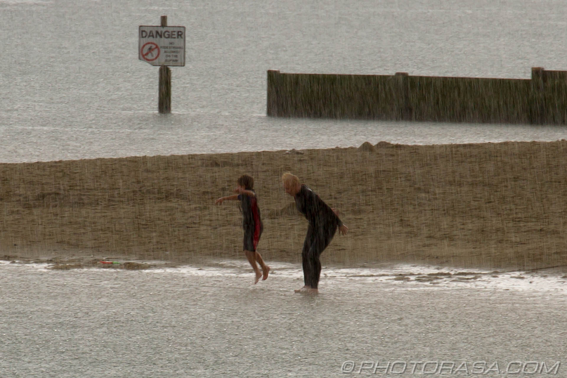 http://photorasa.com/lyme-regis/playing-on-the-beach-in-a-rainstorm/