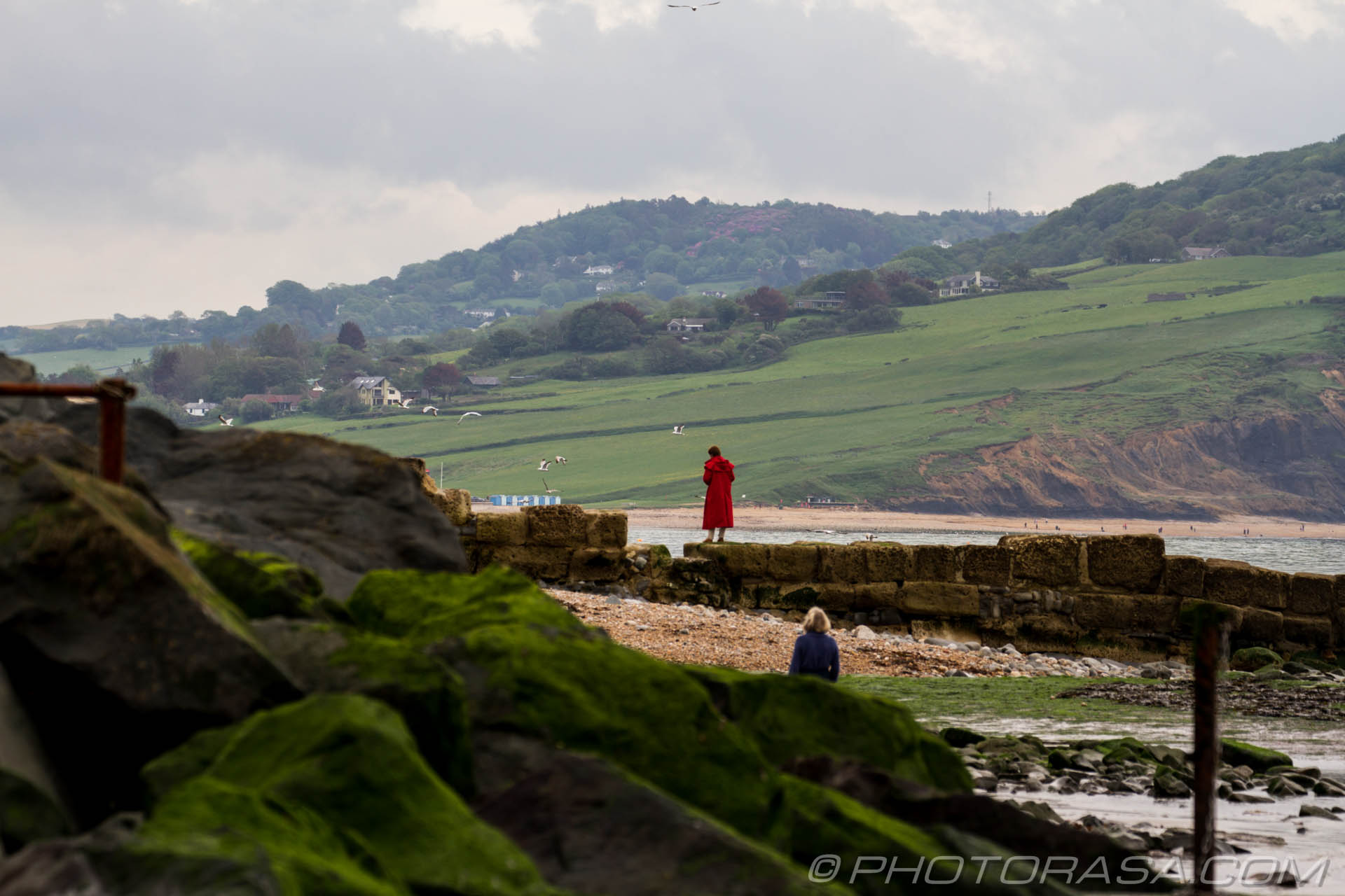 http://photorasa.com/jurassic-coast-lyme-regis/red-lady-by-the-rocks/