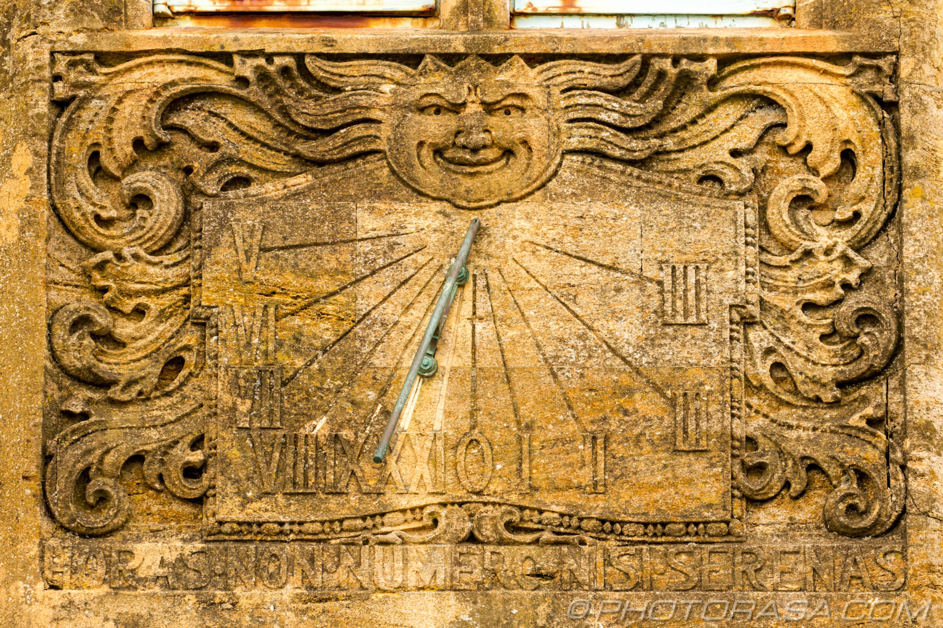 http://photorasa.com/lyme-regis/sun-dial-on-front-wall-of-house/