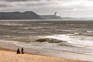 watching the kitesurfer at lyme regis