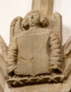 angelic stone wall carving