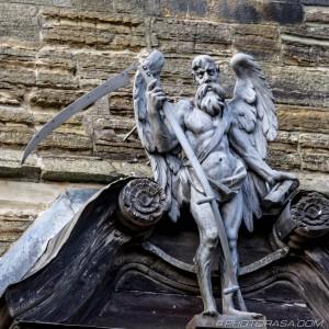 bearded angel of death with scythe