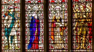 stained glass of two men and two women