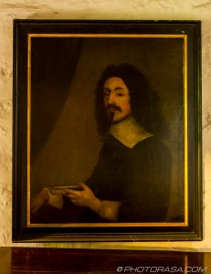17th century painting of protestant priest holding a book