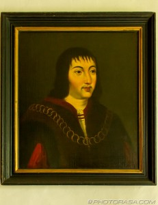painting of unknown man wearing gold linked chain