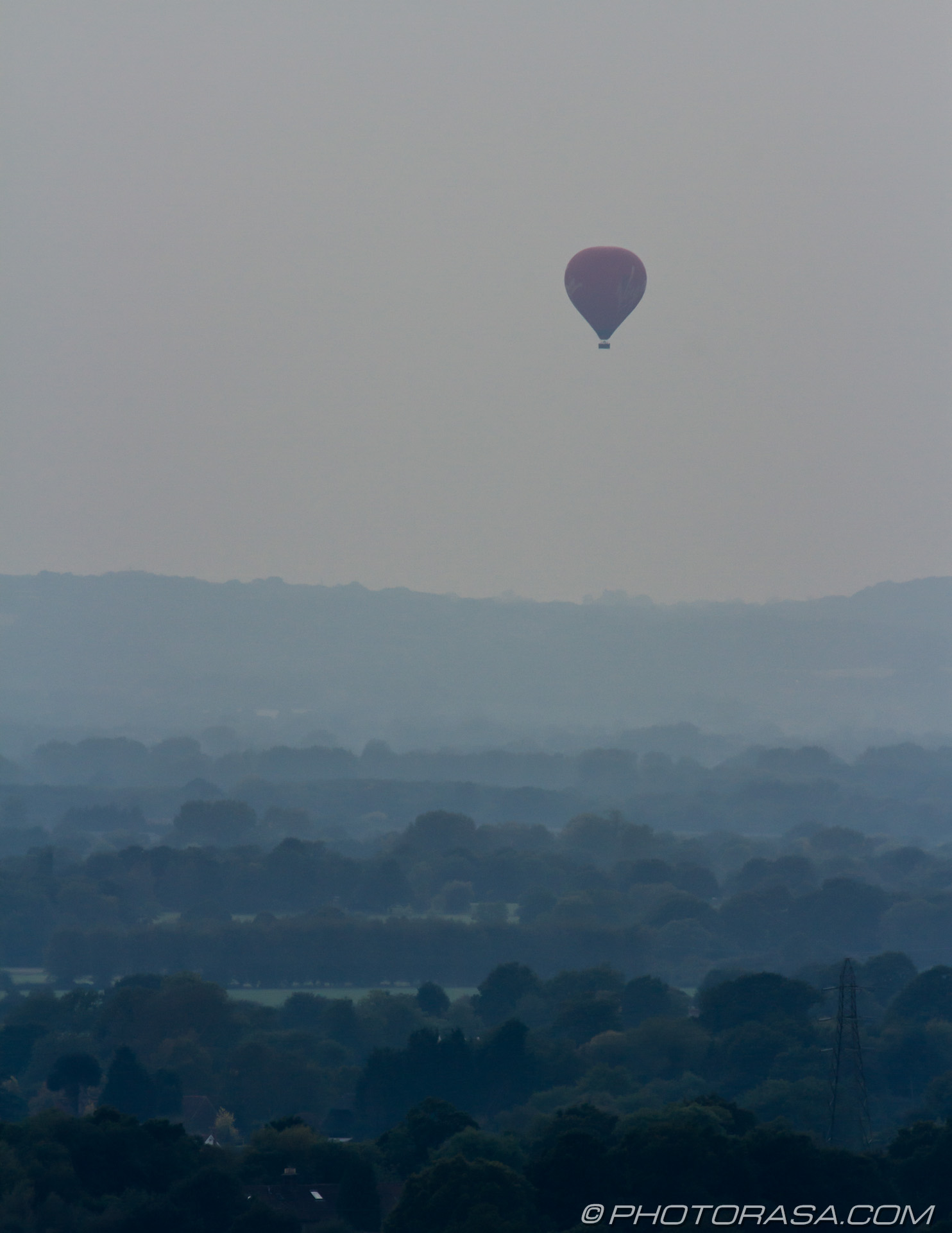http://photorasa.com/balloons-evening-sky/hot-air-ballon-of-misty-countryside/