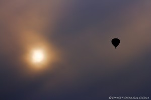 hot air balloon silhouette and sun