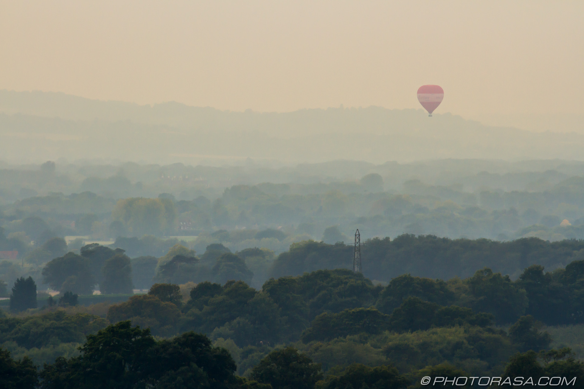 http://photorasa.com/balloons-evening-sky/red-air-balloon-over-misty-woodland/