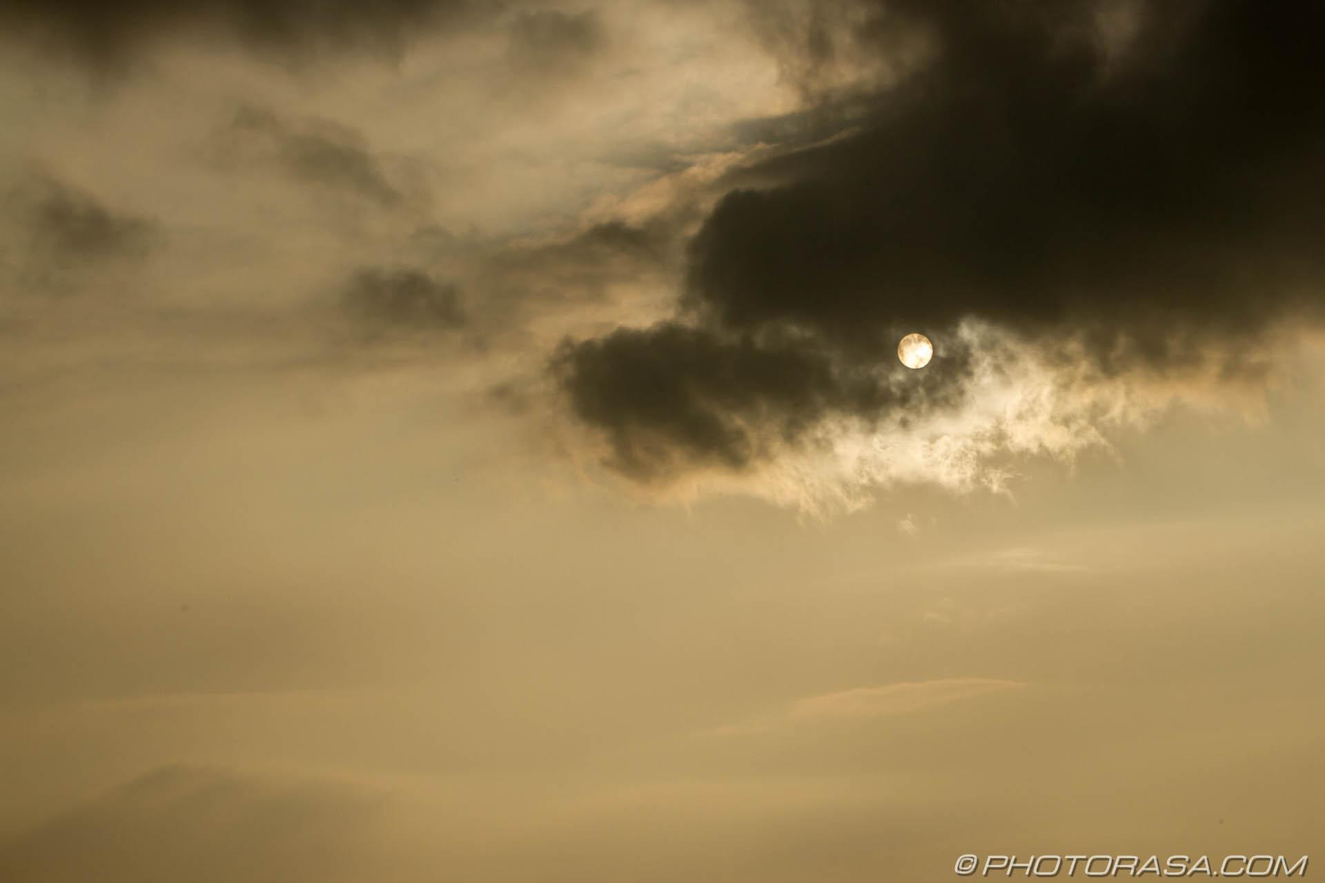 https://photorasa.com/sun-shining-through-the-clouds/sun-behind-a-dark-cloud/