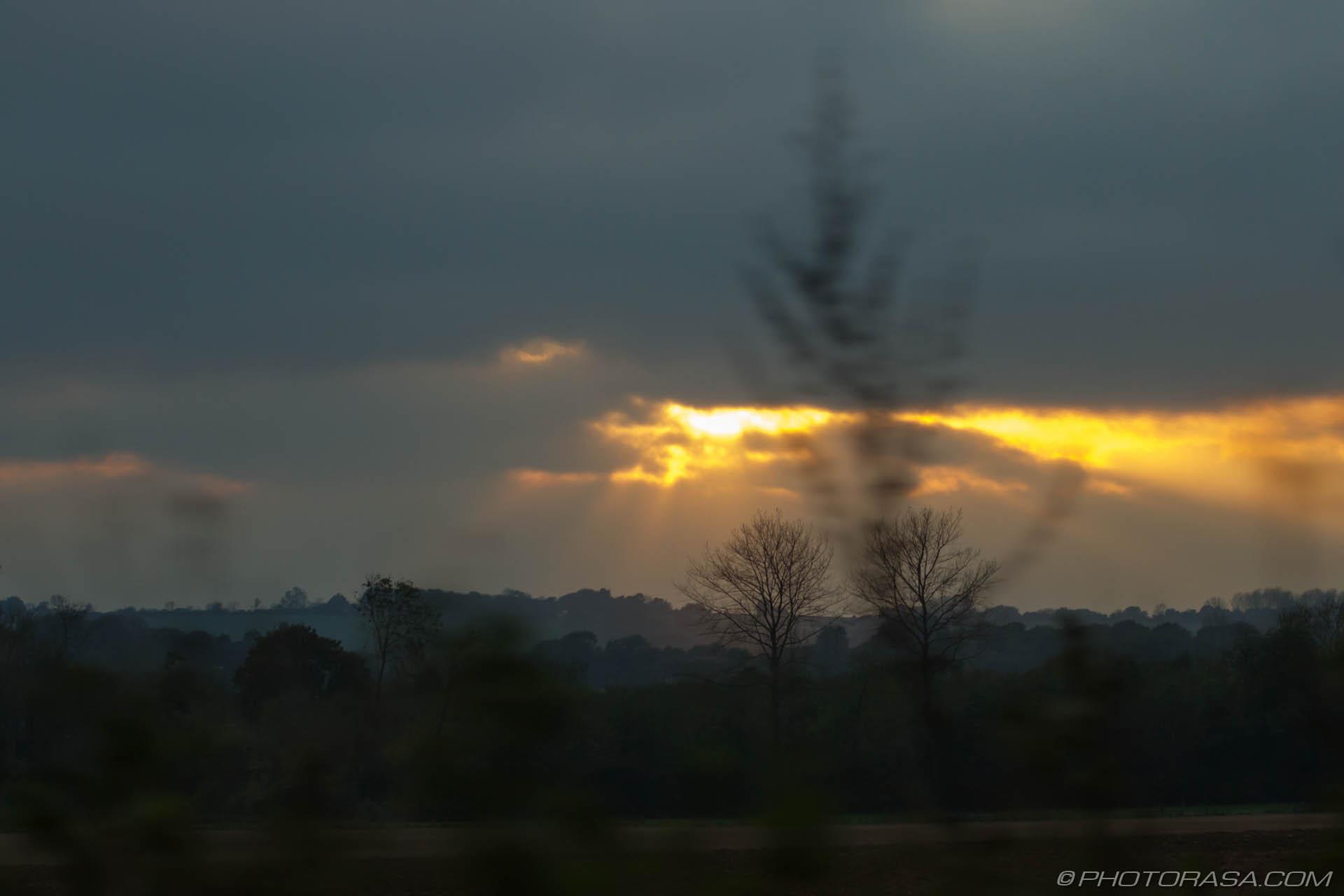https://photorasa.com/sun-shining-through-the-clouds/sun-peeking-through-clouds/