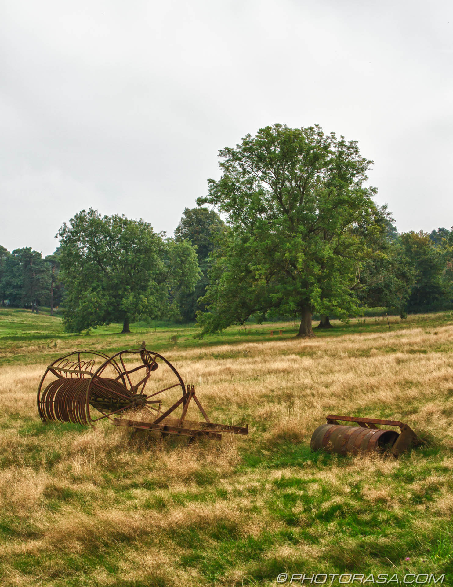 http://photorasa.com/farming/rusting-farm-machinery-in-field/