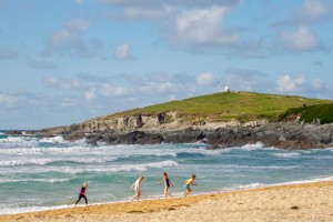 children playing on fistral beach