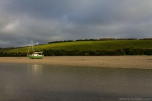grounded boat on river gannel estuary