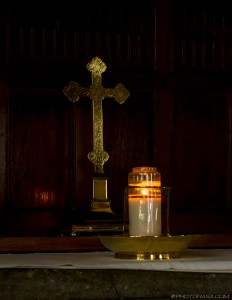 golden cross and candle