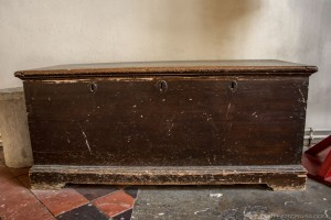 old wooden church chest with 3 keyholes