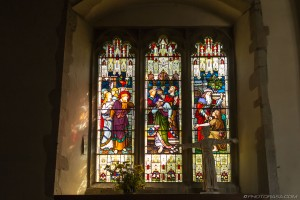 stained glass and religious statue
