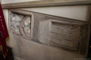 stone coffin embedded in church wall