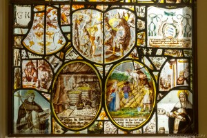 stained glass of farming scenes and rural workers